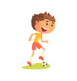 young soccer player kicking the ball cartoon vector image vector image