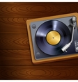 Vinyl record player on wooden background vector image vector image