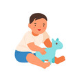 cute smiling child playing with soft toy vector image vector image