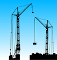 Silhouette of two cranes working on the building vector image vector image