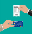hand holding receipt and credit card vector image vector image