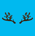 horns of a reindeer on a blue background vector image vector image