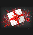 giftbox with red bow realistic confeti and vector image vector image