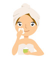 woman putting on cream on her face isolated on vector image vector image