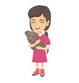caucasian happy girl holding a dog vector image