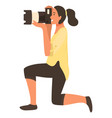 woman paparazzi on knee making professional shoots vector image