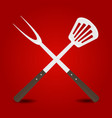 crossed big fork and spatula on red background vector image vector image