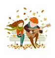 Boy plays guitar for a girl in the autumn park vector image