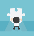 businessman standing in front of blank puzzle vector image