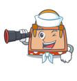 sailor with binocular hand bag mascot cartoon vector image vector image