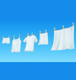 white clean linen and clothes hanging on a rope vector image
