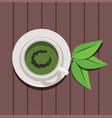 design of cup of green tea and green leaves vector image vector image