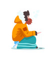 warmly dressed man fishing in a frozen river with vector image vector image