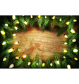 Christmas pine wreath with lights on wooden backgr vector image