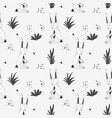 cute pattern with cartoon rabbits and grass vector image