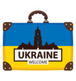 suitcase in colors of ukraine flag vector image