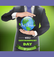 businessman with a globe of concept world environm vector image vector image