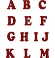 red knitted alphabet on white background vector image vector image