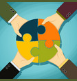 human hands holding pieces of a puzzle vector image