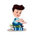 cute boy reading a book sitting on a pile of books vector image