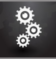 three white gears on black background vector image