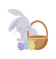 cute rabbit with basket wicker and eggs of easter vector image vector image