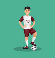 smiling football player standing with a ball vector image vector image