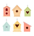 set of wooden bird houses colorful feeders vector image