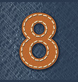 Number 8 made from leather on jeans background vector image vector image