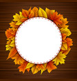 round frame with autumn leaves wooden background vector image