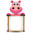 funny hippopotamus cartoon with blank sign vector image