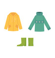 warm knitted sweater rain coat and rubber boots vector image