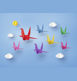 origami made colorful paper bird flying on blue vector image