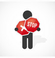 black silhouette of a man holds red stop sign vector image