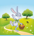 the easter bunny with a basket full of painted vector image vector image