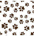 cat or dog brown paw prints seamless vector image vector image