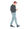 young man walking and looking at smartphone vector image vector image