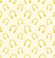 gold seamless pattern of lucky horse shoes vector image