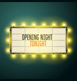 retro movie theater marquee illuminated with old vector image vector image